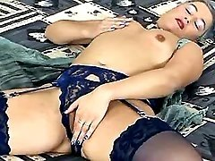 Gray haired mom masturbates in bed