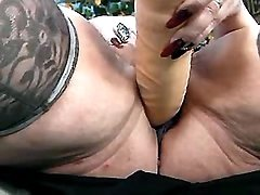 Old pierced cunt stuffed with dildo