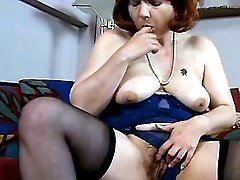 Redhead mom caresses her fuzzy cunt