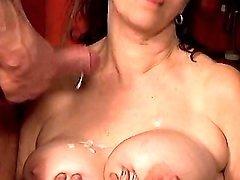 Brunette mature gets cum on tits