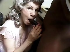 Granny greedily sucking black dick