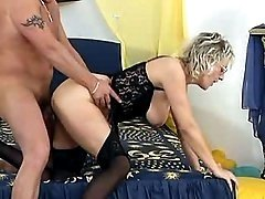 Older woman enjoys doggy style sex