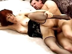 Mom in black lingerie fucks on sofa