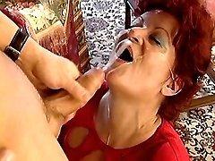 Redhead grandma gets cum on face