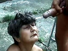 Old lady gets cum from guys outdoor