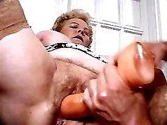 Old dama licked and dildoed by guy