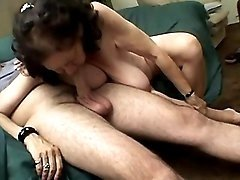 Plump granny sucking cock