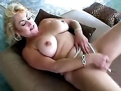 Perky mature solo on sofa