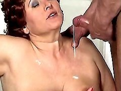 Redhead granny gets cum on boobs