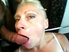 Mature sucks two cocks