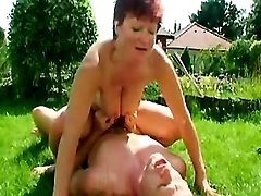 Guy drills lusty mature in nature