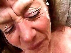 Old slut gets cum in orgy