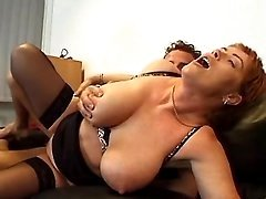 Busty mature has fun in fetish orgy