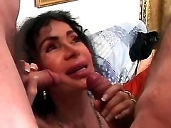 Lusty granny sucks cocks by turns