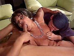 Aged brunette mature sucks two cocks in wild orgy