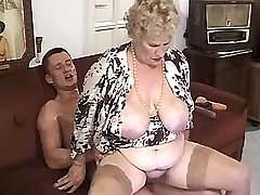 Guy fucks granny w big tits on sofa in all poses