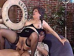 Aged mature in black stockings sucks n rides cock