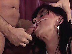 Lewd mature gets strong facial after fuck on sofa
