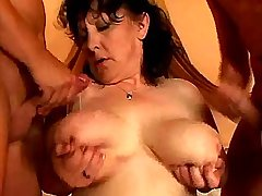 Cutie busty milf gets cum on tits from two cocks