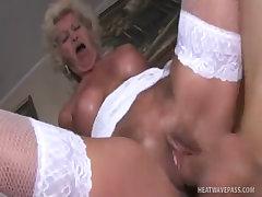 Big titty grandma budai takes a sticky load on her knockers