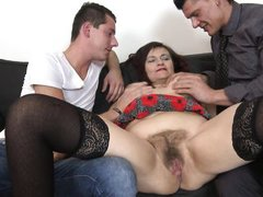 mature lady takes on two young men